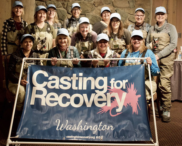 Casting for Recovery in group with their fishing gear on ready to go fly fishing with breast cancer patients